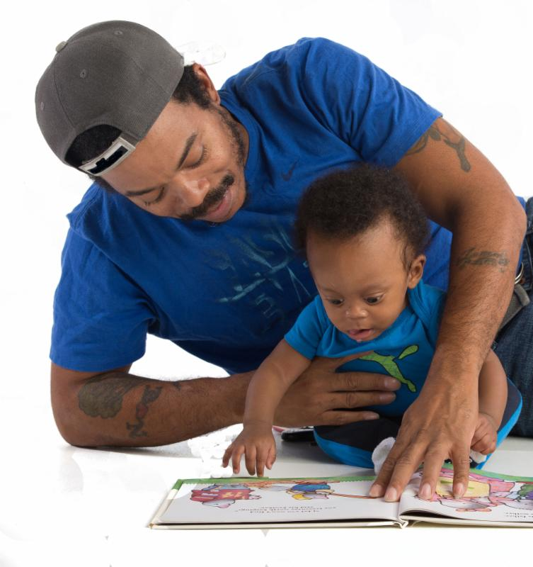 Dad and infant boy reading