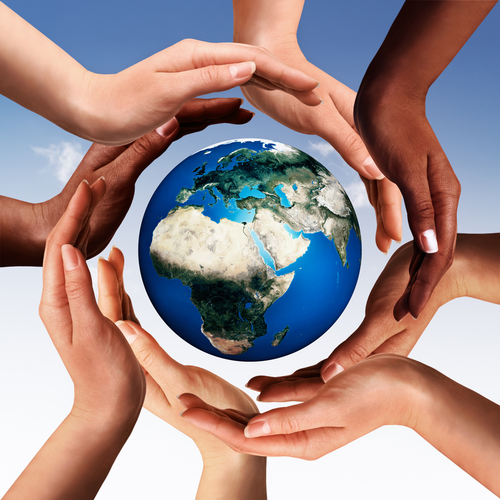 Conceptual peace and cultural diversity symbol of multiracial hands making a circle together around the world the Earth globe on blue sky background. Elements of this image furnished by NASA.