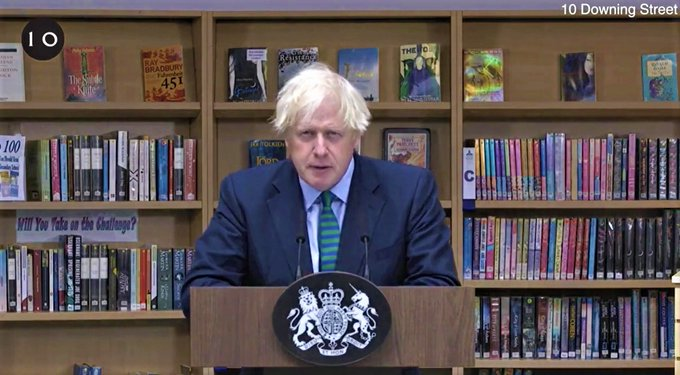 Boris Johnson with a display of books at a school library