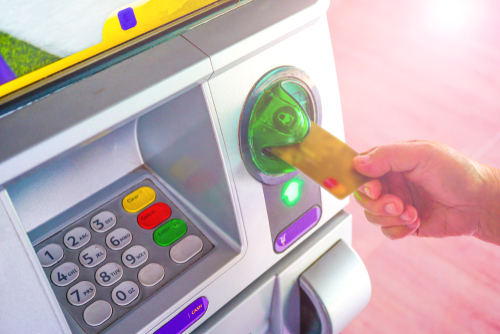 Inserting card to atm machine to withdraw or transfer money finance_ bank and people concept