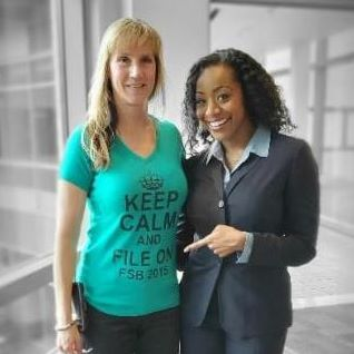 BOE Chair Malia M. Cohen stands with FTB employee with a Keep Calm and File On t-shirt.