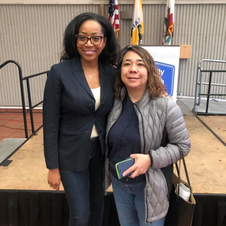 Chair Malia M. Cohen with attendee at the Family Wealth Forum.