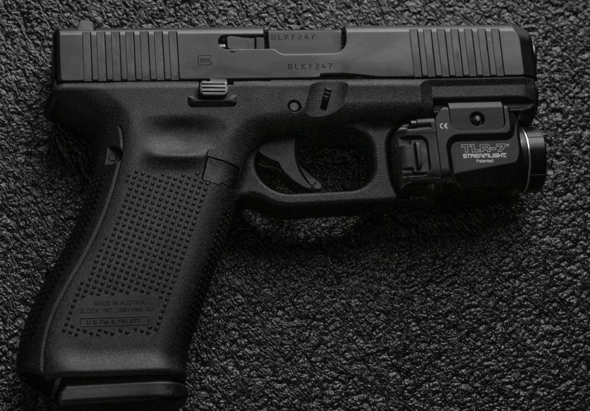 glock gun on black background