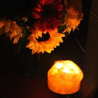 sunflower & lit candle