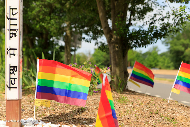 rainbow flags around Peace Pole