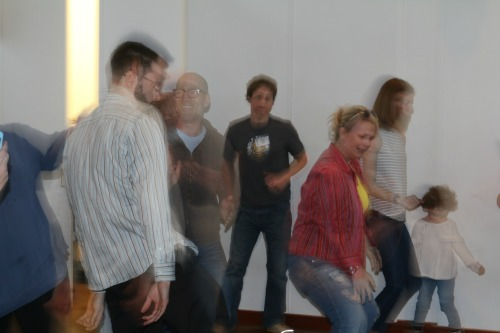 PEOPLE DANCING IN CENTER GALLERY