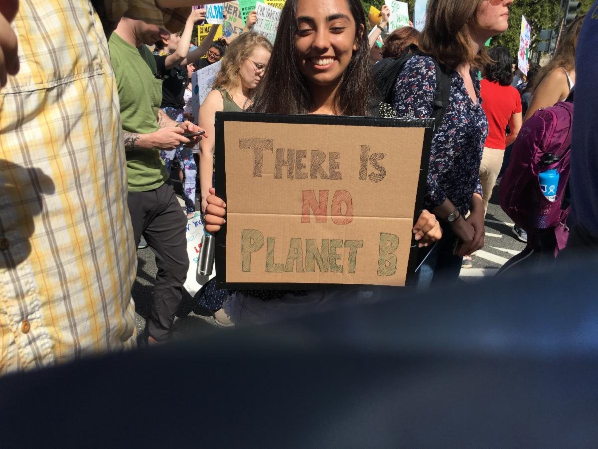 Climate Strike demonstrator with sign