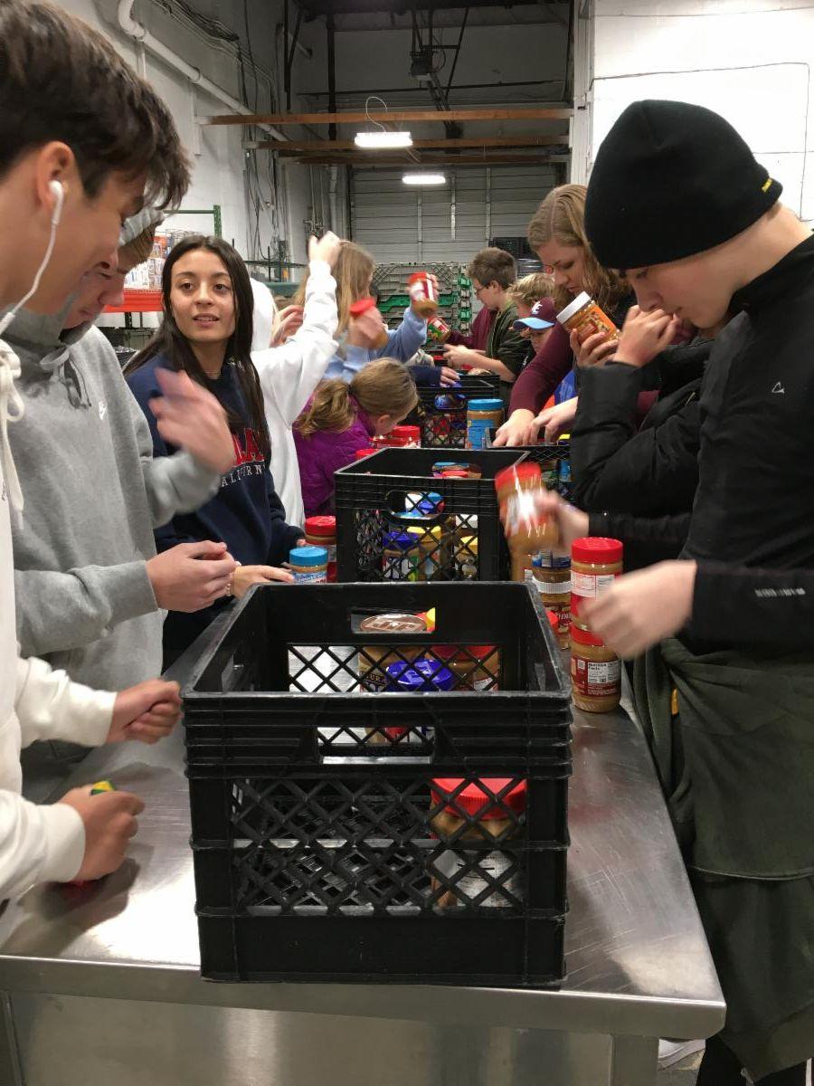 Youth sorting food at AFAC
