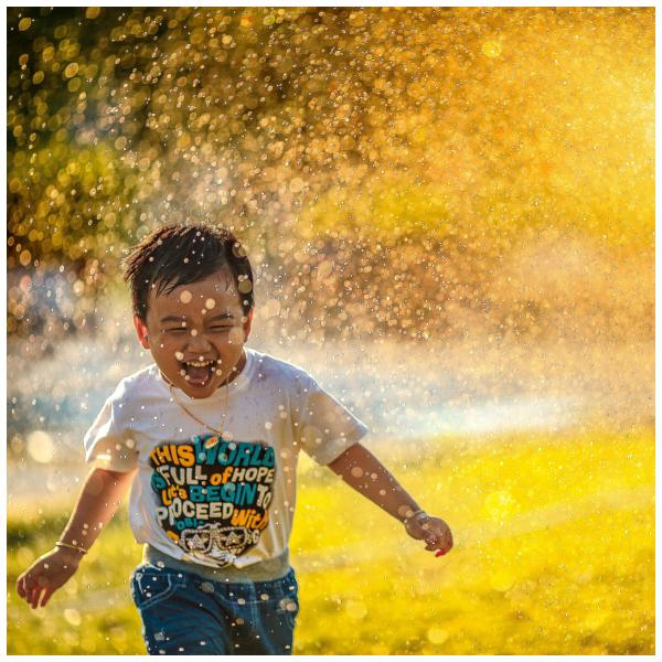 kid in water spray