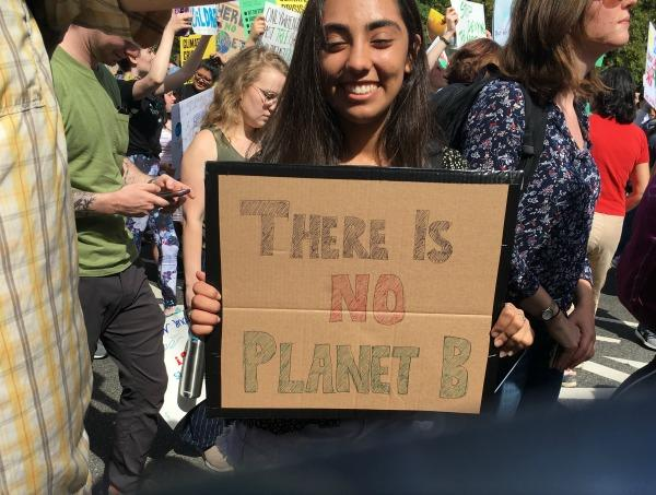 "Teen holding sign ""There is no Planet B"""