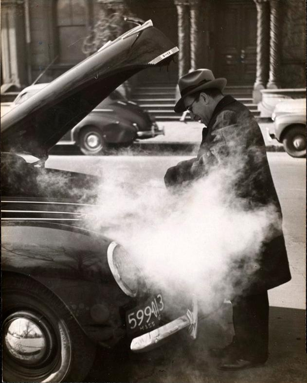 Man fixing car overheating