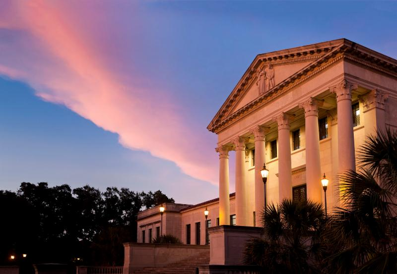 Front of LSU Law building with blue and purple sky