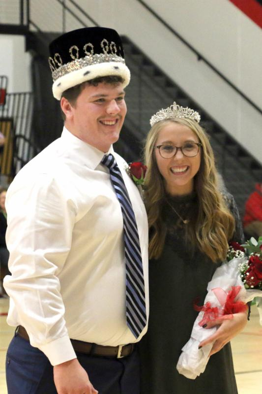 2017 Knight and Queen: seniors Zeke Wall and Madison Beecher. Each wear a crown, Madison holds a bouquet of roses