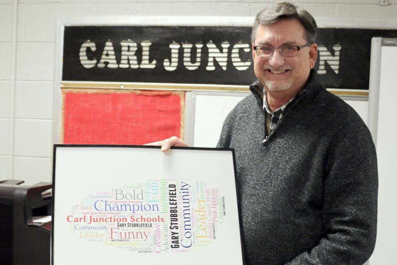 Photo of Gary Stubblefield holding a word art gift