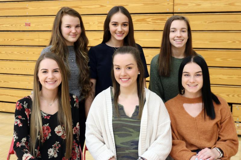 Group of high school girls, front row seated, back row standing. Wrestling Homecoming Court  Front Row - Seniors Loran Dawson, Liz Truelove, and Alyssa Knisley Back Row - Freshman Kylee Degraw, Sophomore Emma Bushnell, and Junior Karlee Rowden.