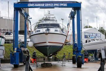 Boat in hoist at Cowes Harbour Services Boatyard