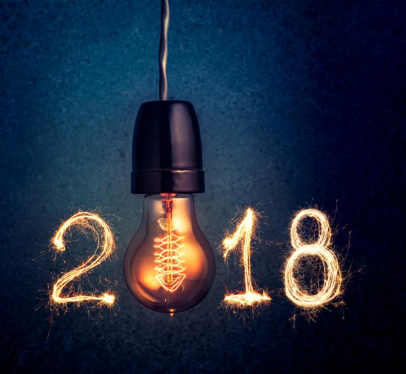 2018 written with Sparkle firework and light bulb abstract 2018 Happy New Year background concept.