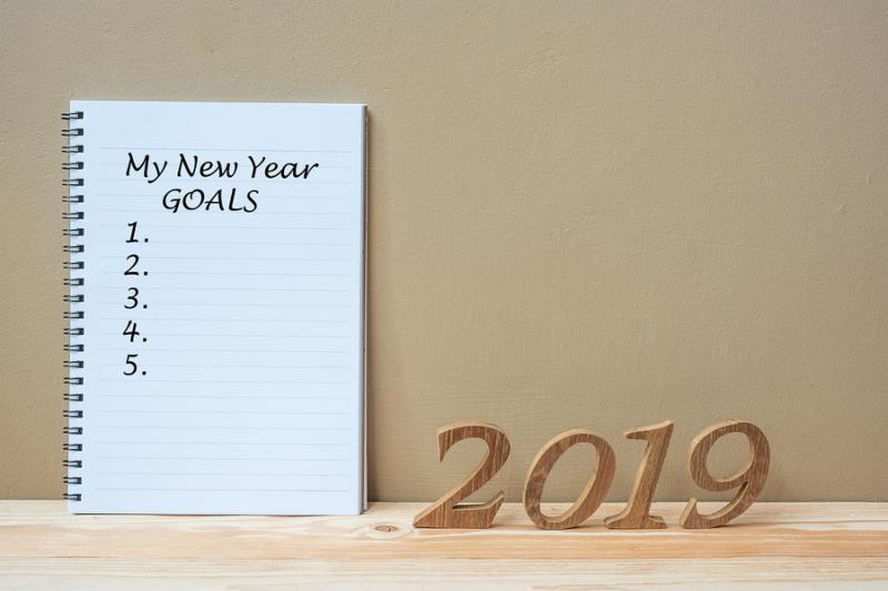 2019 Happy New years with notebook   My New Year Goals   text and wooden number on table and copy space. New Start_ Resolution_ Goals and Mission Concept