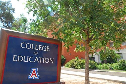 college of education sign in front of building