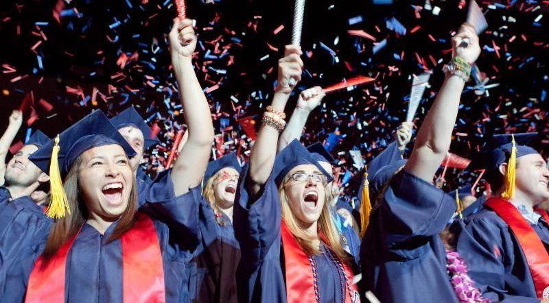 UA students celebrating at graduation