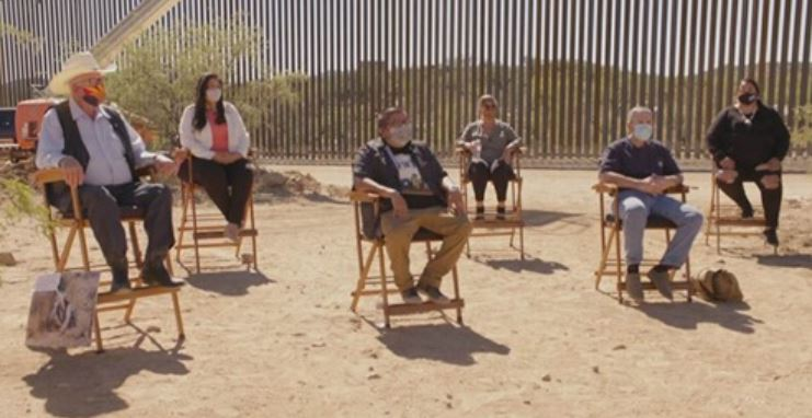 Group of six interviewees in front of the US Mexico border wall. One of which is ITEP student Sara Mae Williams