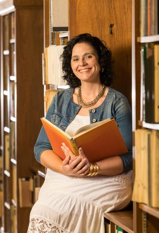Shyla Dogan with a book