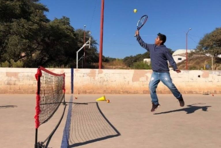 Boy playing tennis at BYTE event