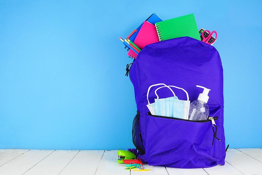 backpack with hand sanitizer and masks