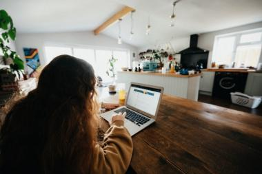 Girl working on laptop at home