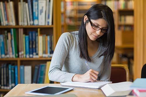 hispanic woman in library