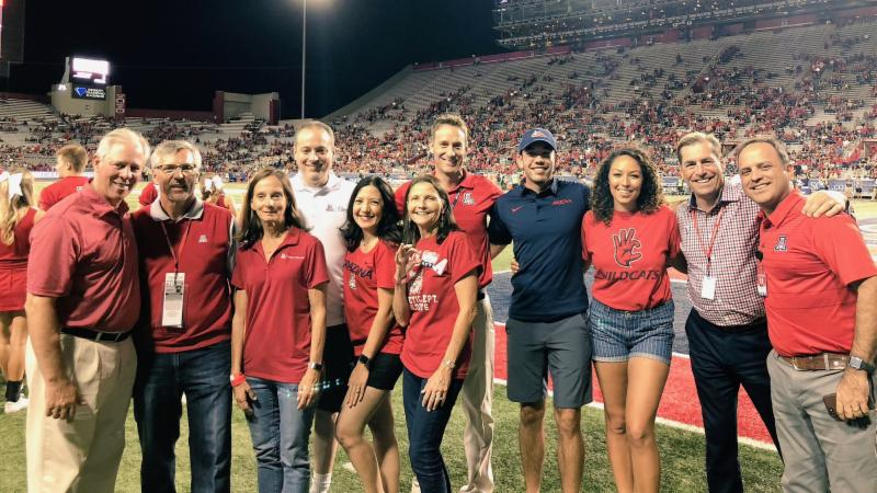Mary Irwin at UA football game on the field