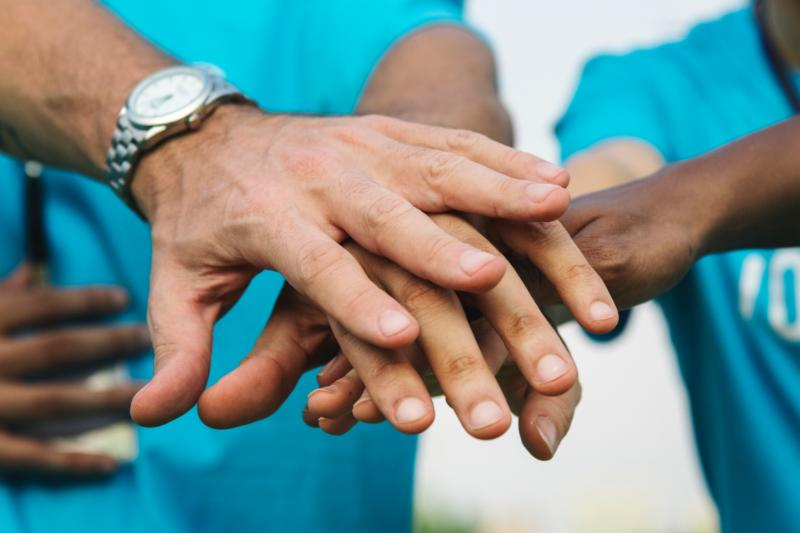 Hands put together in a huddle