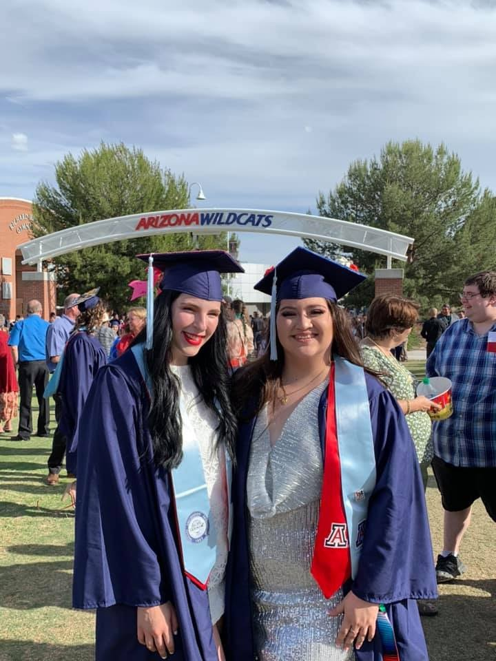 two female grads