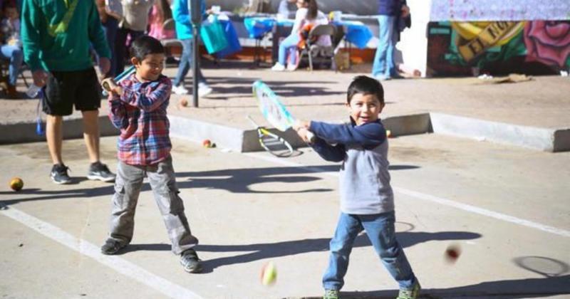 boys playing tennis on the border