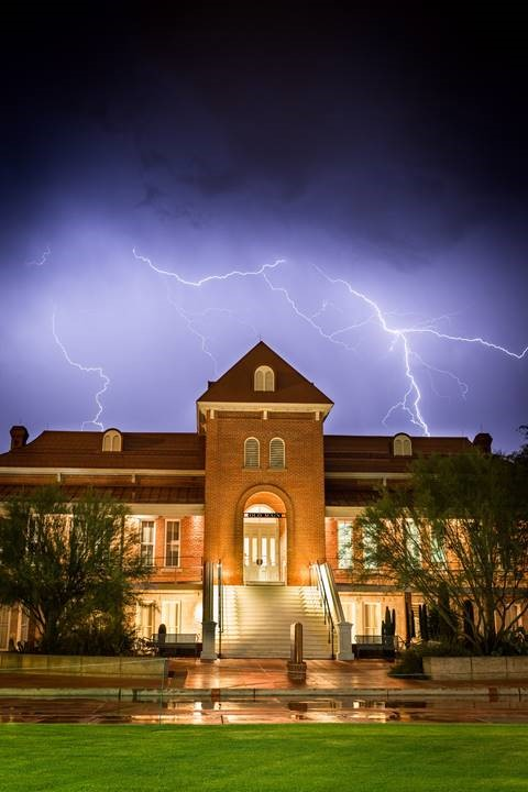Photo of Old Main with lightening in background. Taken by Emma Mendenhall.