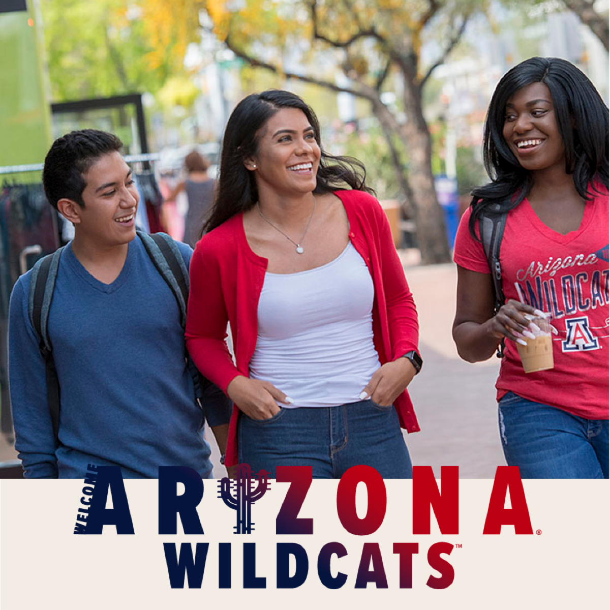 Three UA students in red and blue on campus with text that reads Welcome Arizona Wildcats in red and blue with I replaced by saguaro cactus