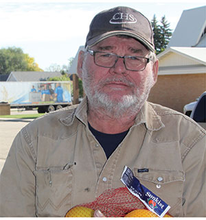 Bill picks up fresh produce from the Great Plains Food Bank Mobile Food Pantry that visits his hometown of Milnor, N.D.