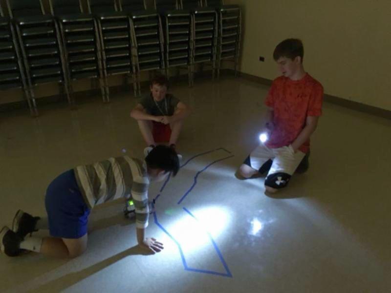 Camp participants programming their robot