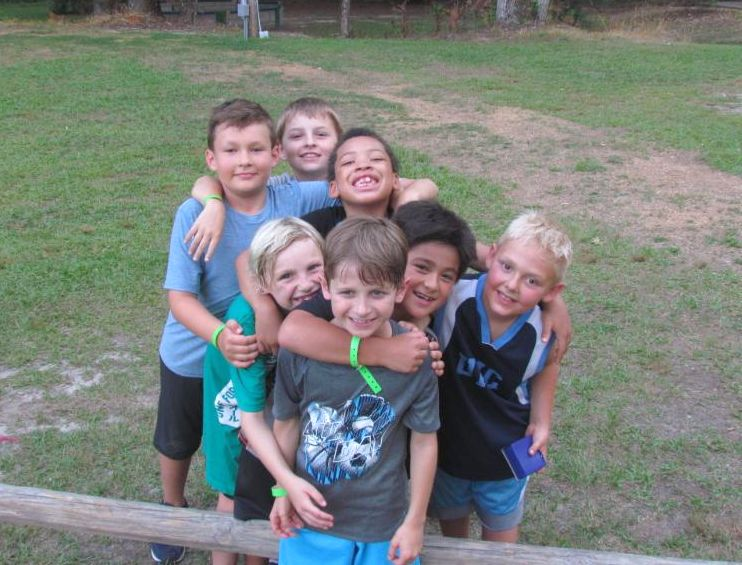 4-H campers embracing in a group hug