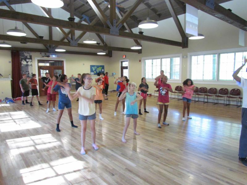 4-H members dancing at camp