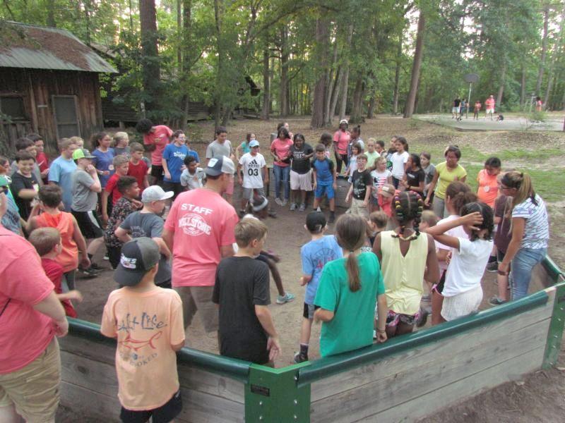Members playing gaga ball at camp