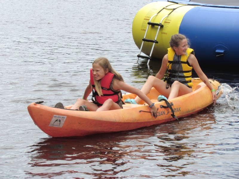 Camp members kayaking on the water
