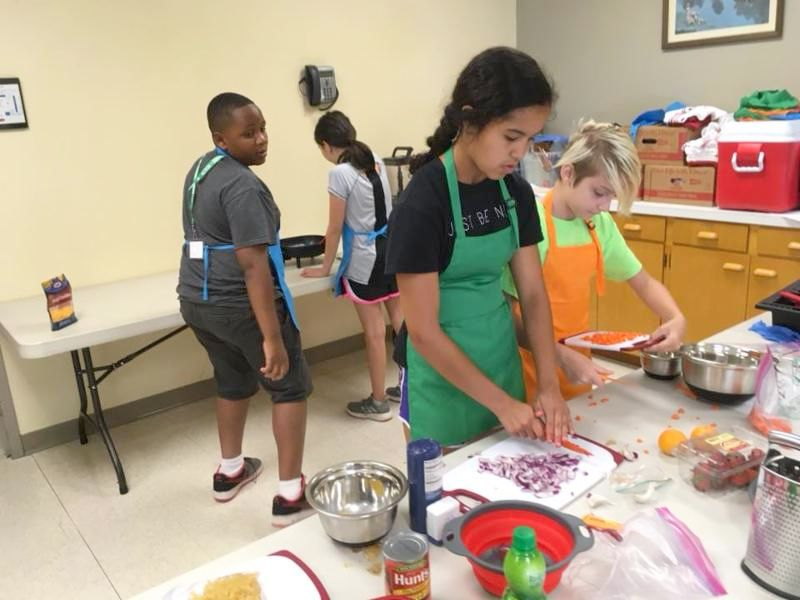 Camp participants preparing their meals for the competition