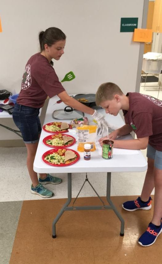 4-H Members preparing their dish for the cooking challenge