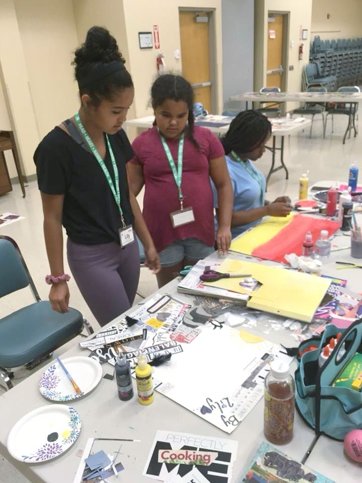 Camp participants working on their vision boards