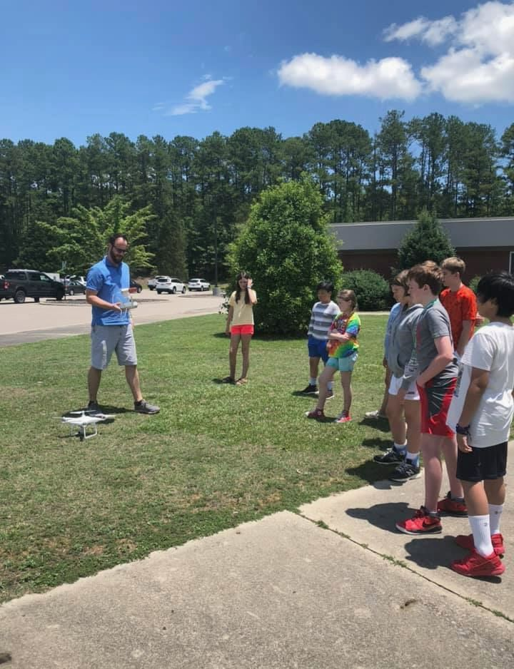 Camp participants learning about drones