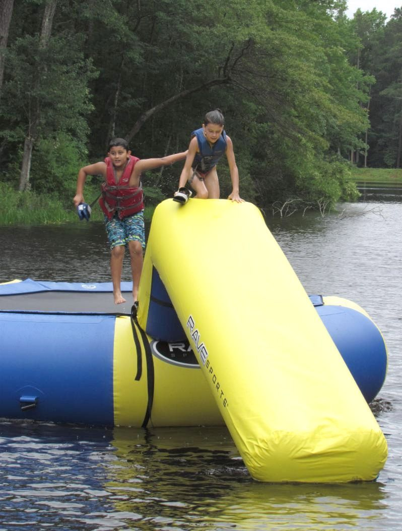 Camp members on the water trampoline