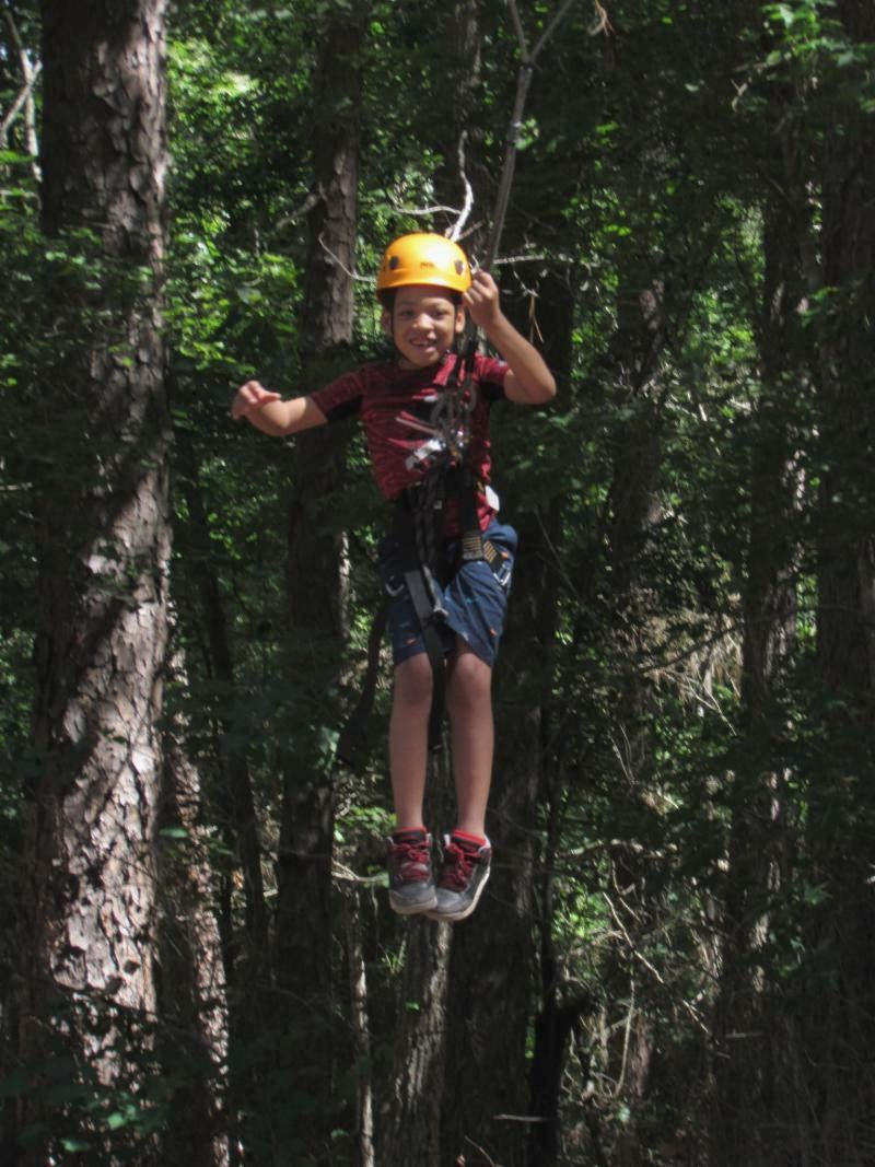 4-H member riding the giant swing at camp