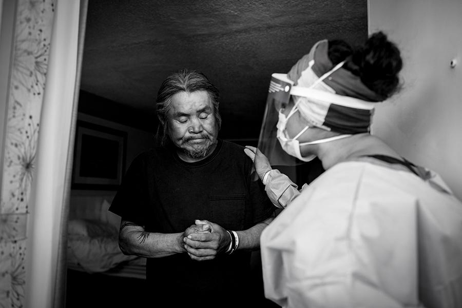 A man greets a health care worker during quarantine in Navajo Nation