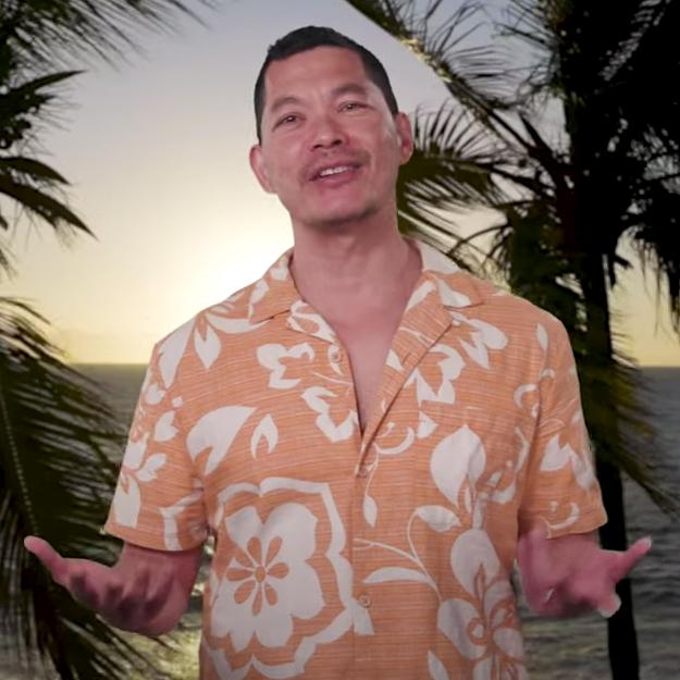 Peter Chin-Hong wearing a Hawaiian shirt with a palm tree backdrop